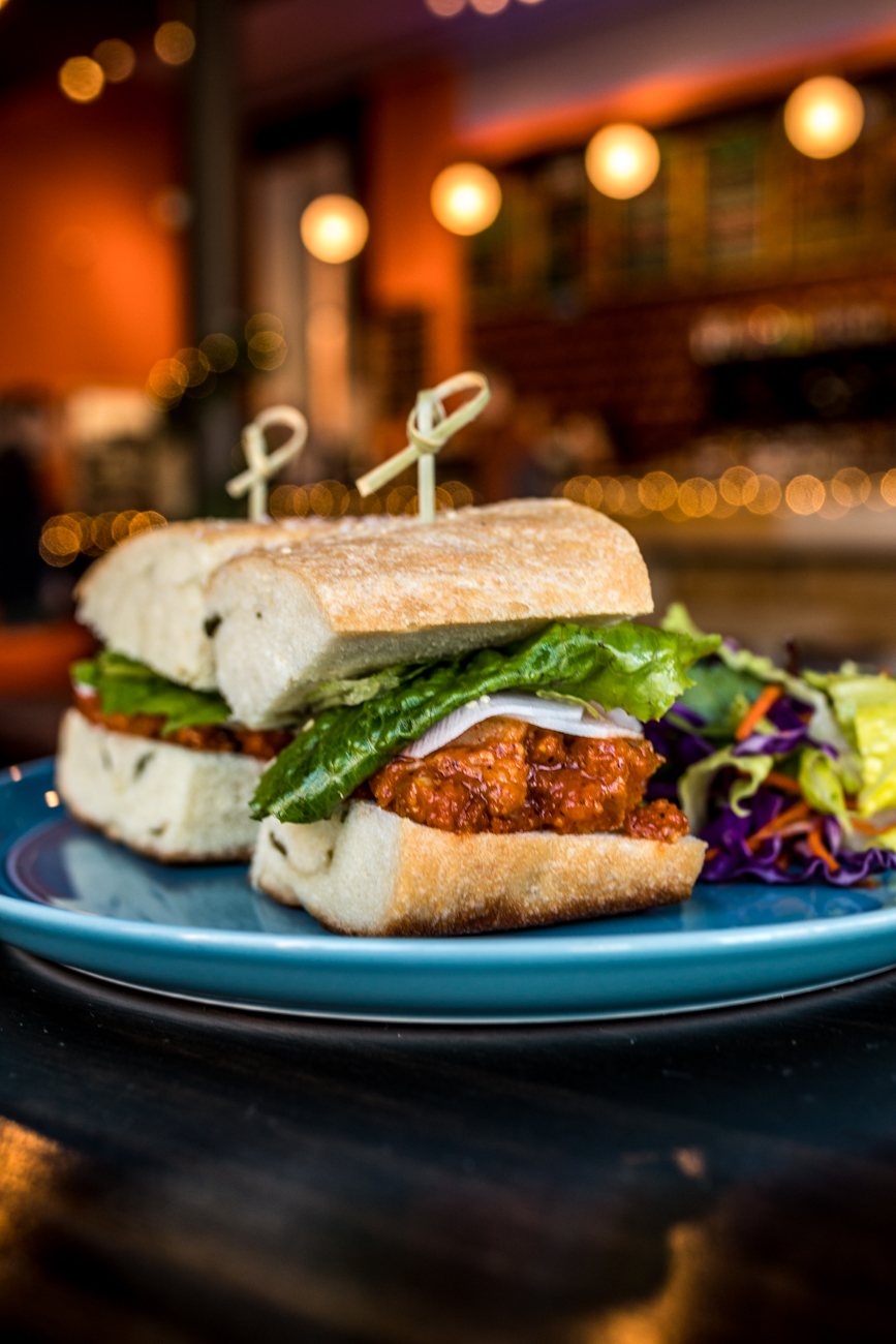Spicy Korean Pork Belly Sandwich: gochujang-marinated pork belly, pickled daikon, and lettuce served on Pang bread / Image: Catherine Viox // Published: 1.8.20