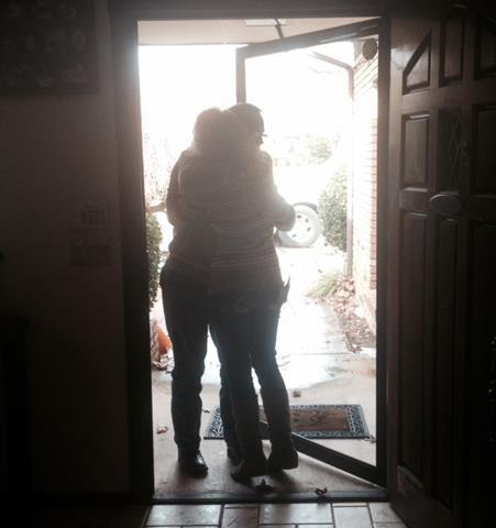 Allison Mullins and Jim Deal embrace at Allison's home.