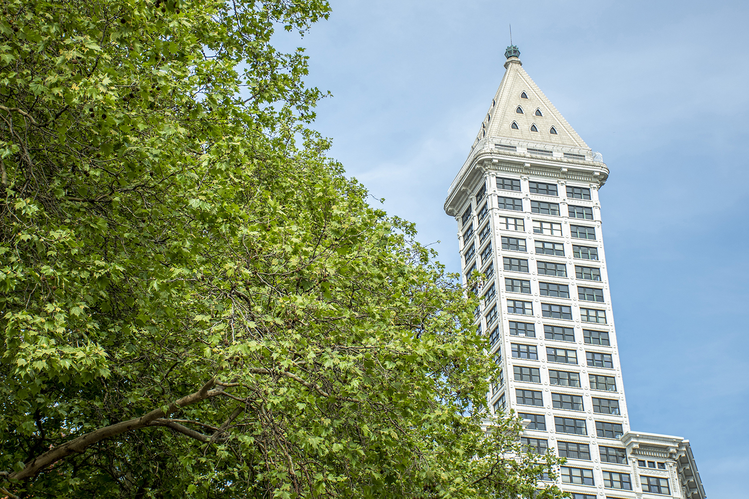 Built in 1914, the Smith Tower is one of the most instantly recognizable icons in Seattle. The 484 feet tall, 38-story Neoclassical landmark was the very first skyscraper in the city, and was also one of the tallest buildings in the U.S. outside of New York City at the time. Plus, there's a private apartment in the pyramid at the very top. (Image: Rachael Jones / Seattle Refined)