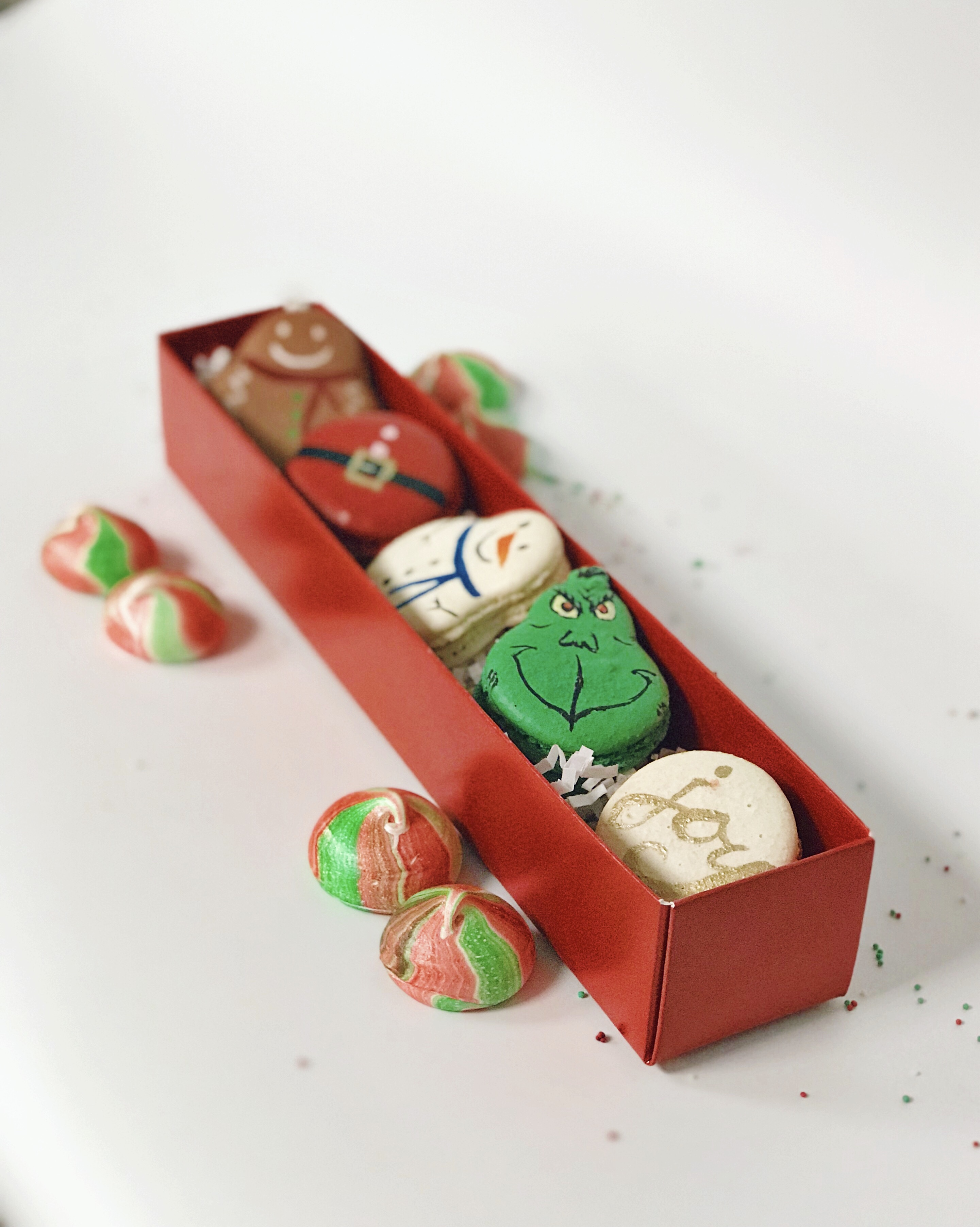 As per usual, Tiffany MacIsaac and her sweet squad have gone all out for the holidays. Festively shaped macarons, chocolate bark bedazzled with edible glitter, and her vertical play on the Bûche de Nöel that arrives as a stump with a cardinal perched on top. (Image: Courtesy Buttercream Bakeshop)<p></p>