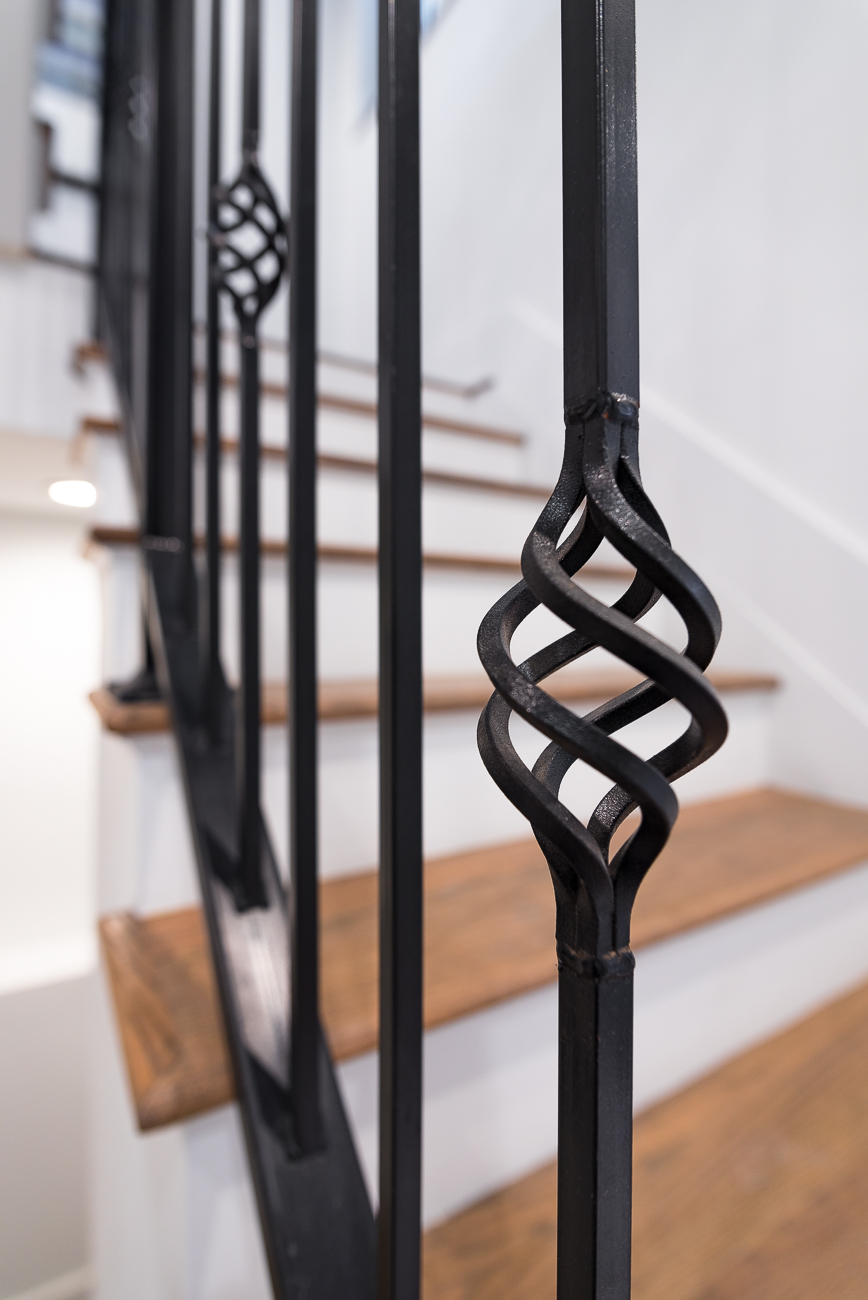 The finishes aren't standard and boring. While it's largely neutral, 1533 Republic features small touches with flair, such as the railings for the main staircase. / Image: Phil Armstrong, Cincinnati Refined // Published: 2.4.19