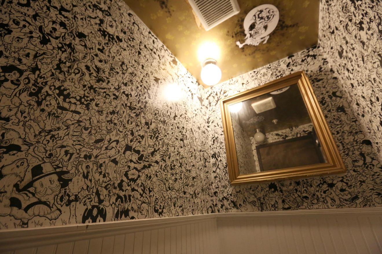 The hand-drawn bathroom walls at Toki are also great for when you're sobbing and calling your ex in after downing several cocktails. Not that we'd know from experience or something... (Amanda Andrade-Rhoades/DC Refined)