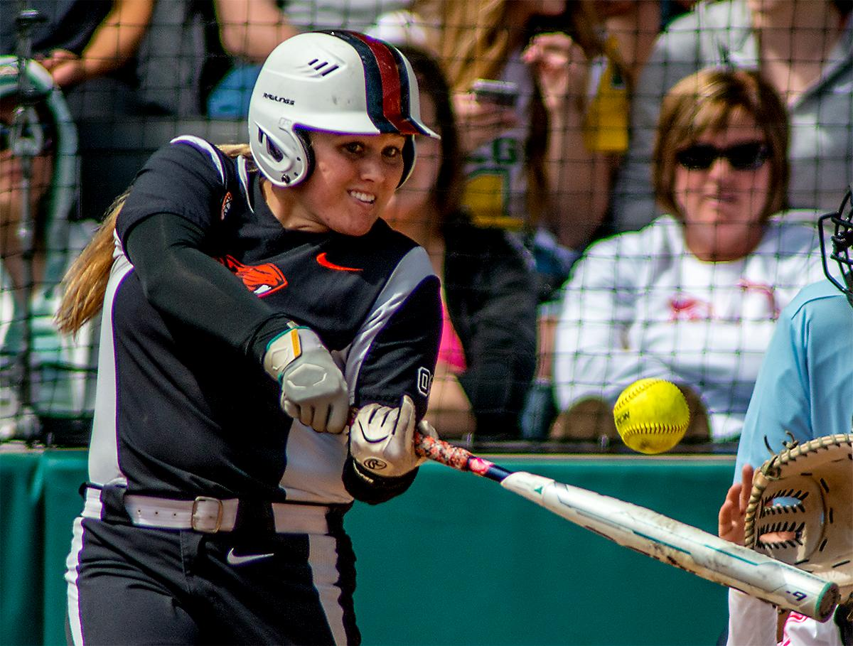 The Beavers' Natalie Hampton (#15) keeps her eyes on the ball as she takes a swing for it. The Oregon Ducks defeated the Oregon State Beavers 7-2 in game two of the three-game Civil War series at Jane Sanders Stadium on Saturday. The final game of the series will be on Sunday at 3:00 p.m. at Jane Sanders Stadium. Photo by August Frank, Oregon News Lab