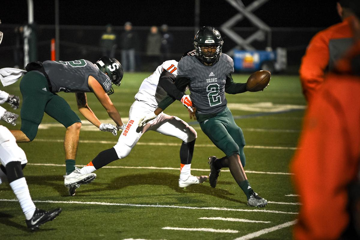 Sheldon wide receiver Raymond Woodie (#2) is pushed out of bounds during Sheldon's 48-7 victory over Beaverton in the first round of the state high school playoffs.  Photo by Jeff Dean Oregon News Lab