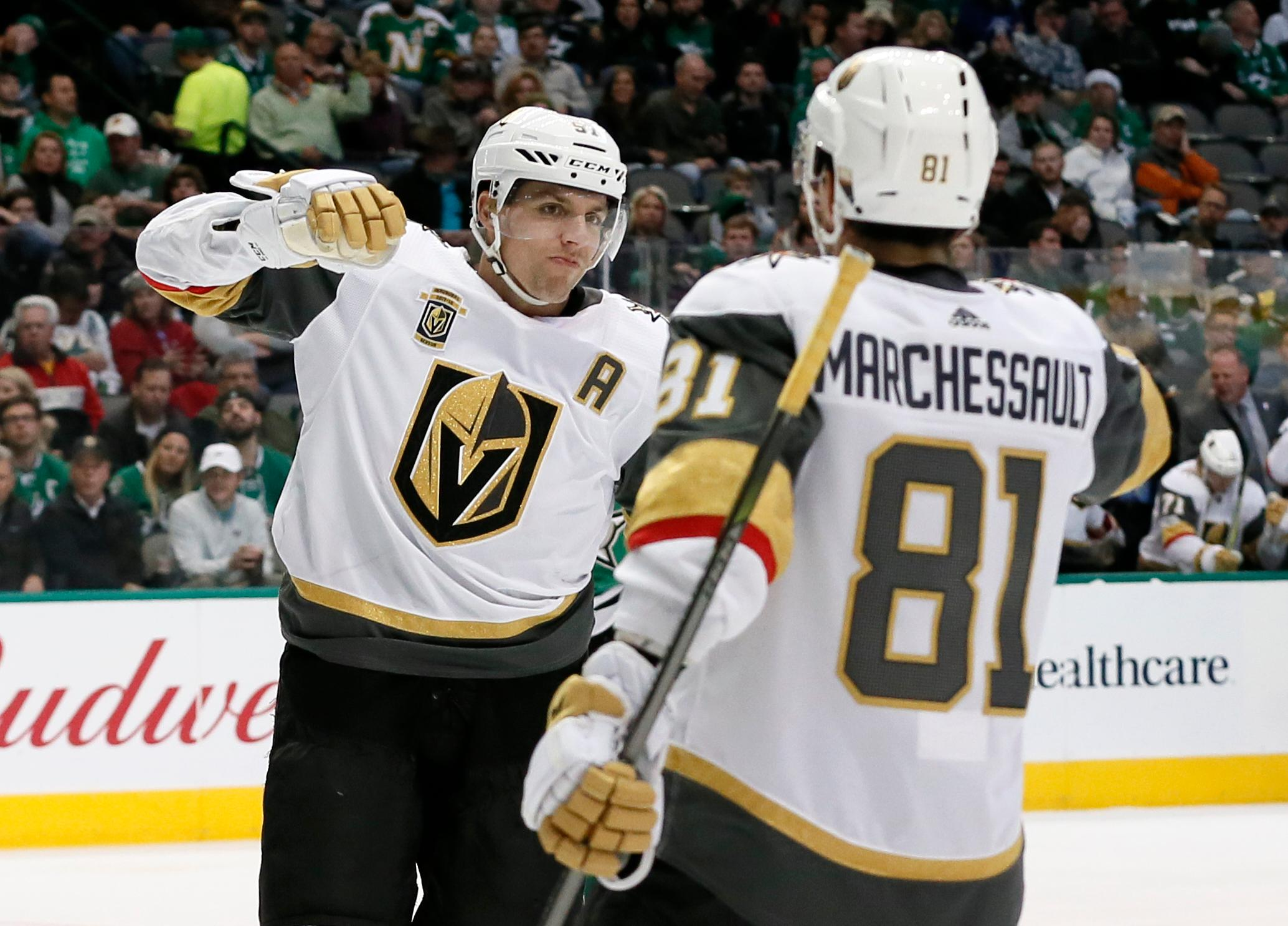 Vegas Golden Knights' David Perron (57) and Jonathan Marchessault (81) celebrate a goal by Perron during the second period of an NHL hockey game against the Dallas Stars on Saturday, Dec. 9, 2017, in Dallas. (AP Photo/Tony Gutierrez)