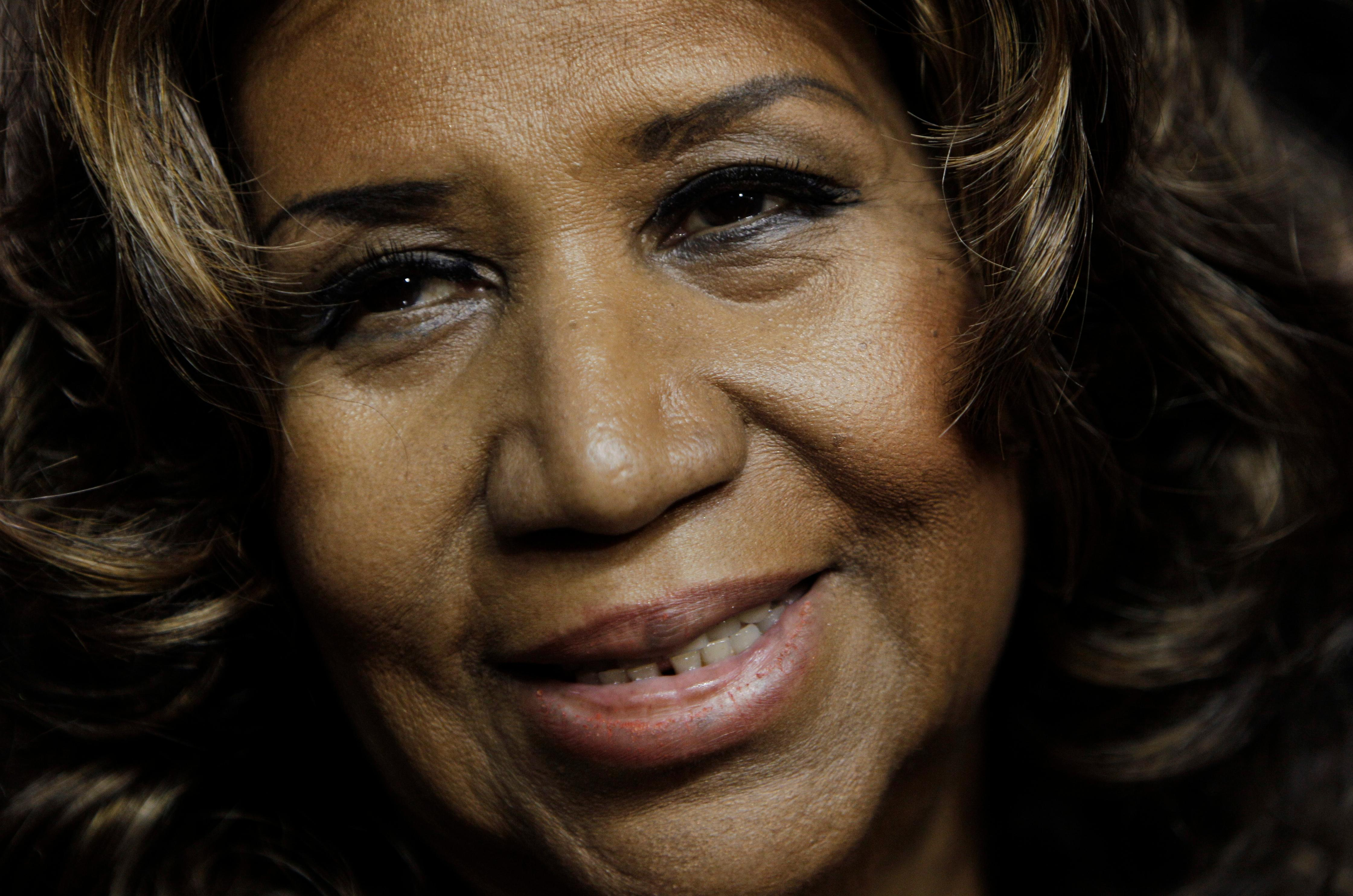 FILE - In this Feb. 11, 2011 file photo, Aretha Franklin smiles after the Detroit Pistons-Miami Heat NBA basketball game in Auburn Hills, Mich.   Franklin died Thursday, Aug. 16, 2018 at her home in Detroit.  She was 76. (AP Photo/Paul Sancya, File)