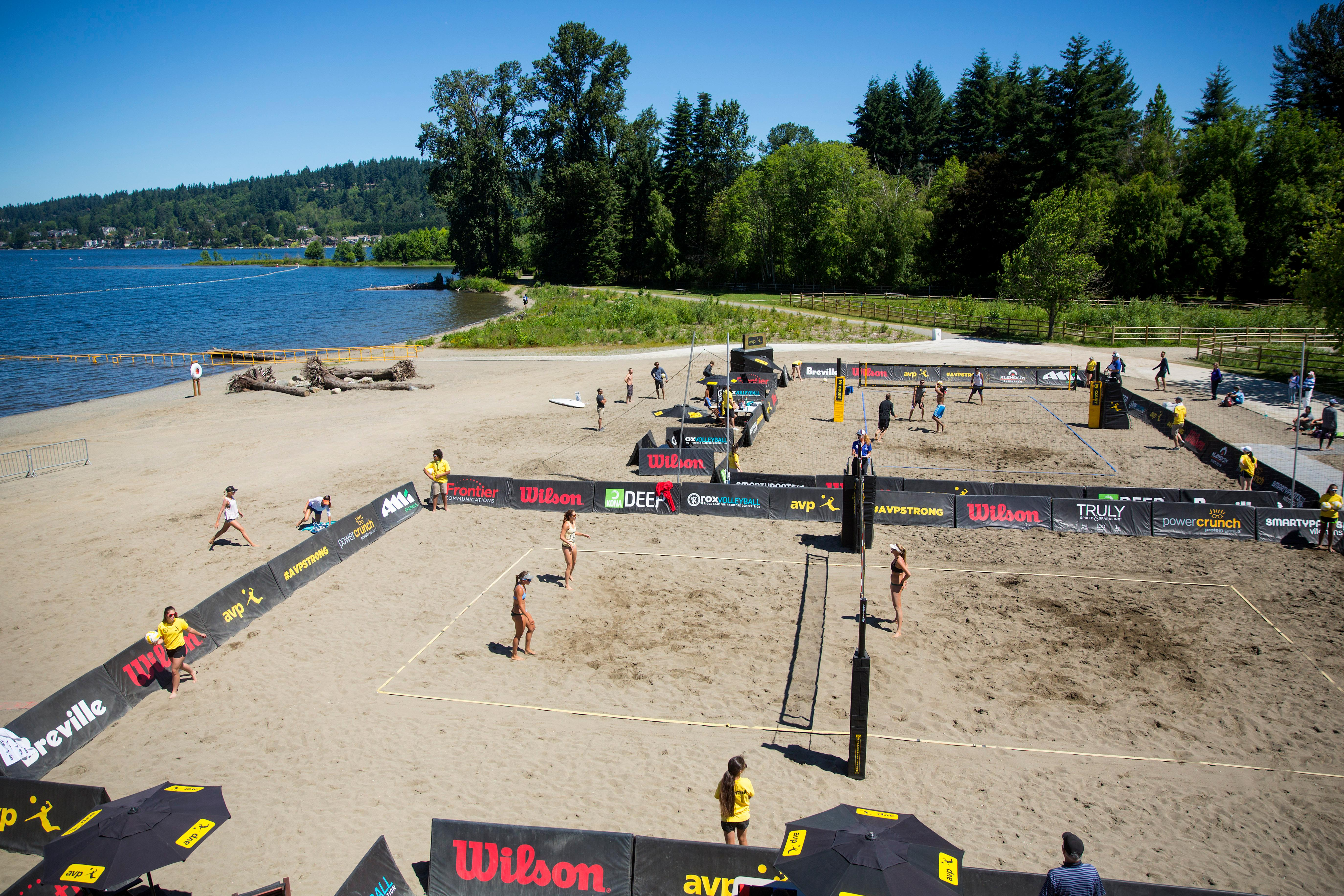 Volleyball atheletes take to the beach at Lake Sammamish State Park for the qualifiers of the AVP Seattle Open. The tournament will continue over the weekend, and the winners will walk away with a $150,000 prize. (Sy Bean / Seattle Refined)