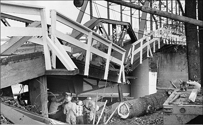 { }The Columbus Day storm was the fiercest windstorm in Oregon's recorded history. Here, workers examine damage to the Van Buren Street Bridge in Corvallis. (photo courtesy of Oregon State University Archives)