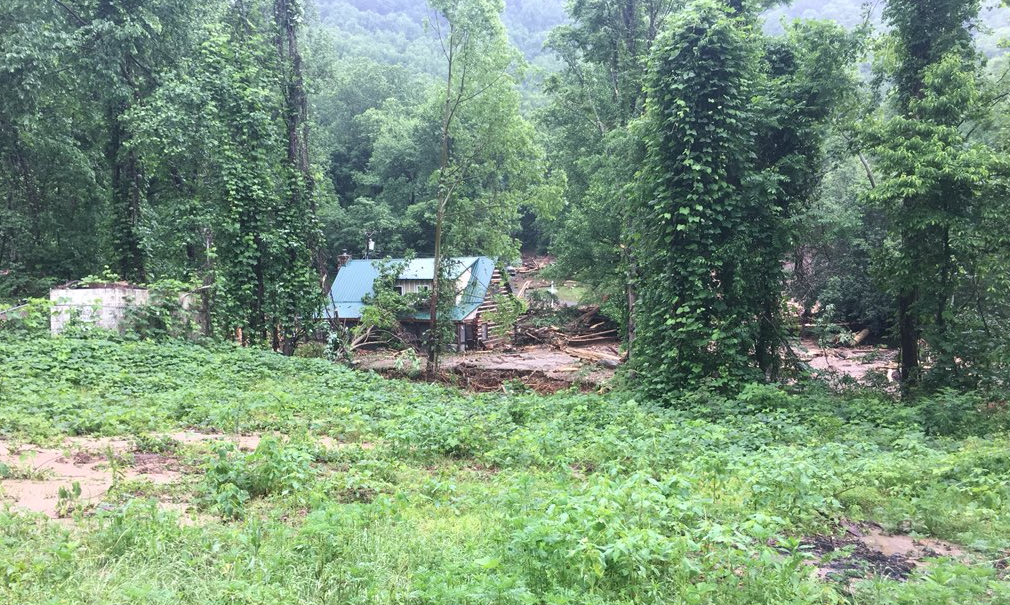 Searchers have recovered the body of a woman whose home was crushed by a mudslide in an area of rolling hills near the town of Tryon (Photo: WLOS)