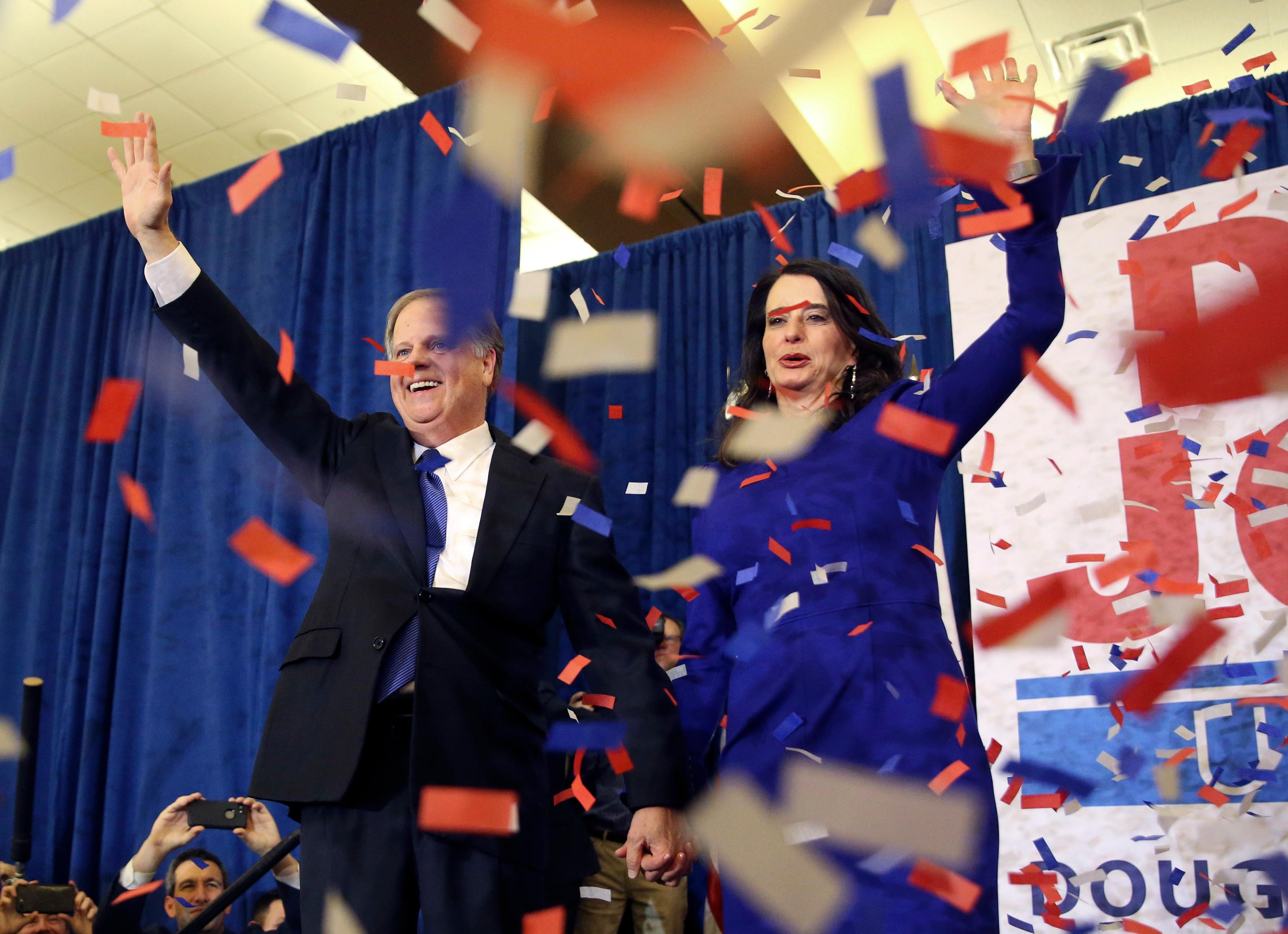 Democratic candidate for U.S. Senate Doug Jones and his wife Louise wave to supporters before speaking during an election-night watch party Tuesday, Dec. 12, 2017, in Birmingham, Ala. (AP Photo/John Bazemore)