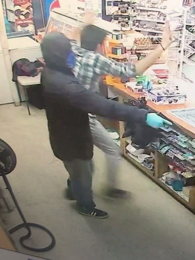 Surveillance from another recent robbery at Airline Market, April 13.