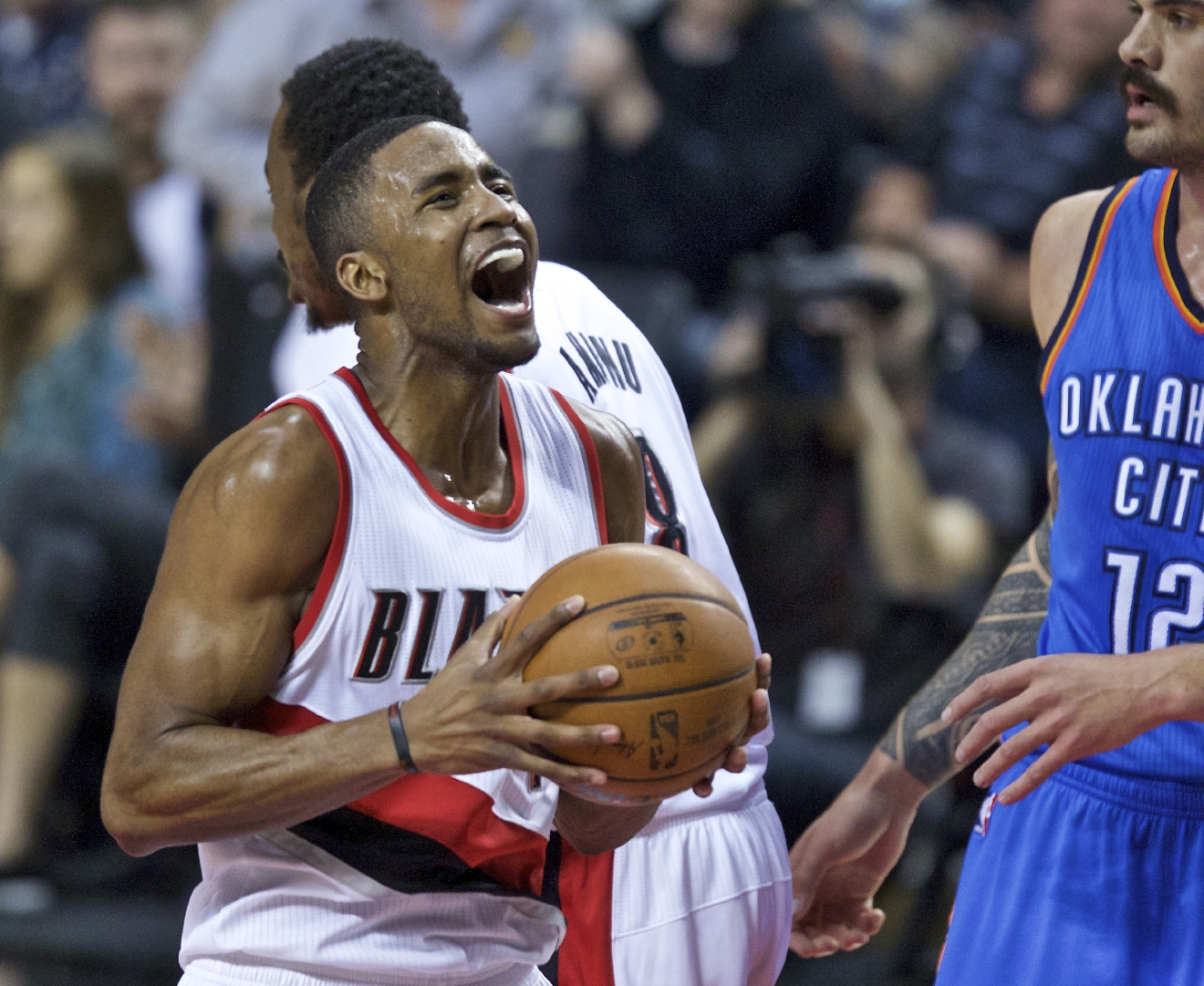 Portland Trail Blazers forward Maurice Harkless, left, reacts after scoring a basket against Oklahoma City Thunder center Steven Adams, right, during the first half of an NBA basketball game in Portland, Ore., Wednesday, April 6, 2016. (AP Photo/Craig Mitchelldyer)