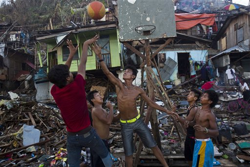 Typhoon Haiyan survivors play basketball in a destroyed neighborhood in Tacloban, Philippines.
