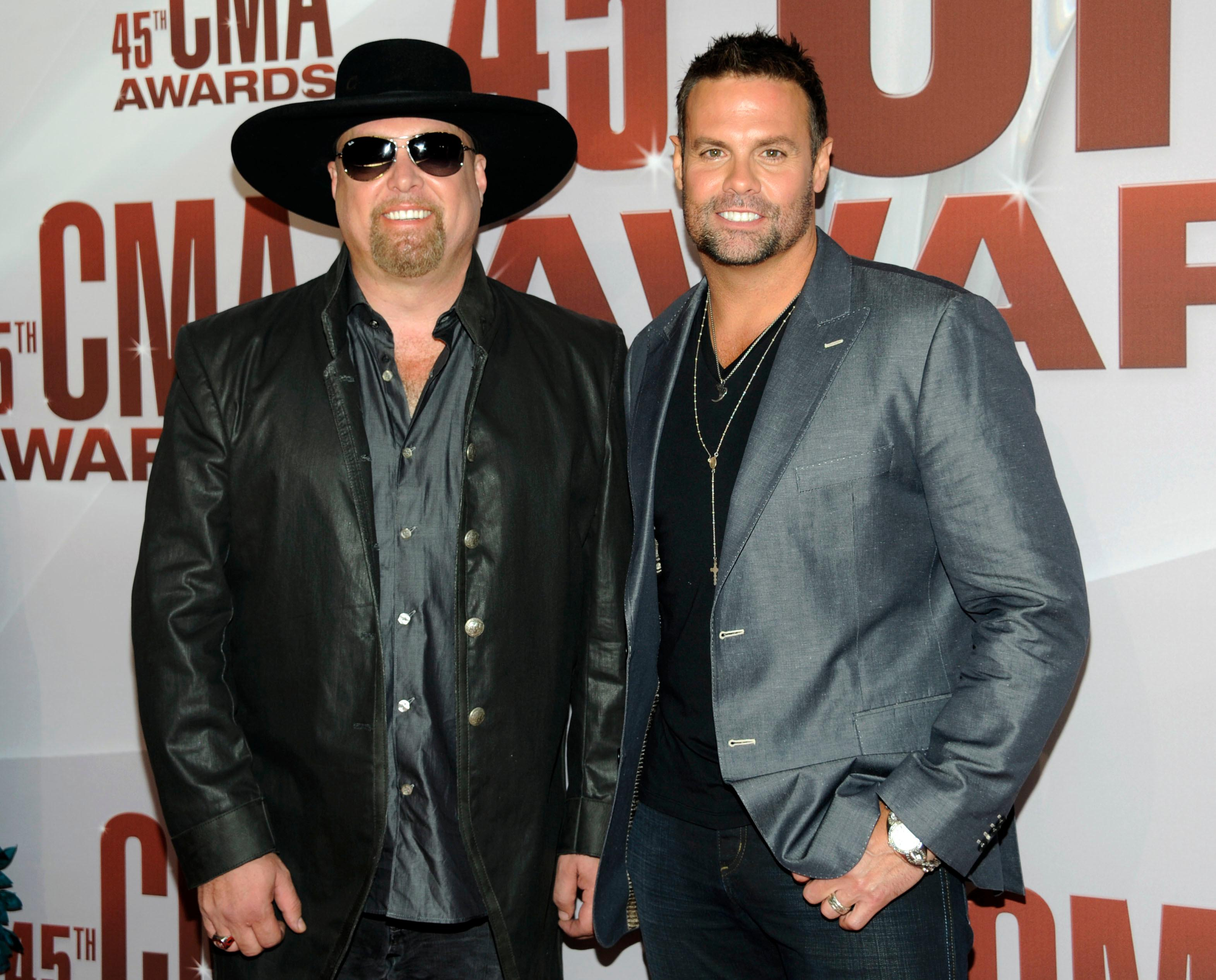 FILE - In this Nov. 9, 2011 file photo, Eddie Montgomery, left, and Troy Gentry of Montgomery Gentry arrive at the 45th Annual CMA Awards in Nashville, Tenn. Gentry, one half of the award-winning country music duo Montgomery Gentry, died Friday, Sept. 8, 2017, in a helicopter crash, according to a statement from the band's website. He was 50.  The group was supposed to perform Friday at the Flying W Airport & Resort in Medford, N.J. (AP Photo/Evan Agostini, File)