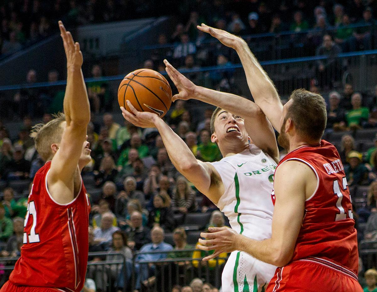 Oregon Ducks Payton Pritchard (#3) attempts to aim for the basket and get past Utah's defense. The Utah Utes defeated the Oregon Ducks 66-56 on Friday night at Matthew Knight Arena. This is the first Pac-12 conference game loss at home for the Ducks since January of 2015. This also ended the five home game winning streak for the Ducks against the Utah Utes. Photo by Rhianna Gelhart, Oregon News Lab