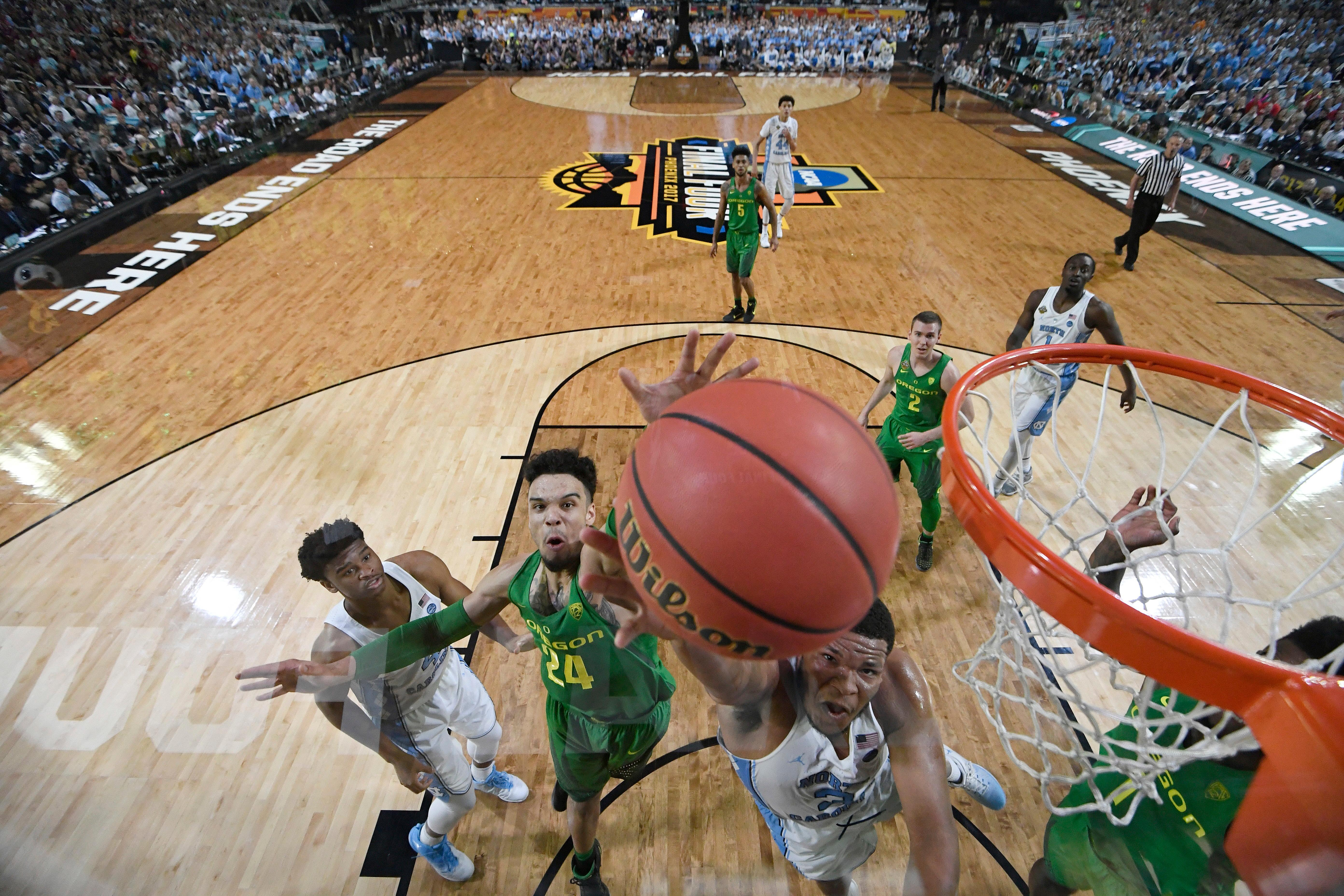 North Carolina's Kennedy Meeks, right, goes up for a shot against Oregon's Dillon Brooks (24) during the second half in the semifinals of the Final Four NCAA college basketball tournament, Saturday, April 1, 2017, in Glendale, Ariz. (AP Photo/Chris Steppig, Pool)