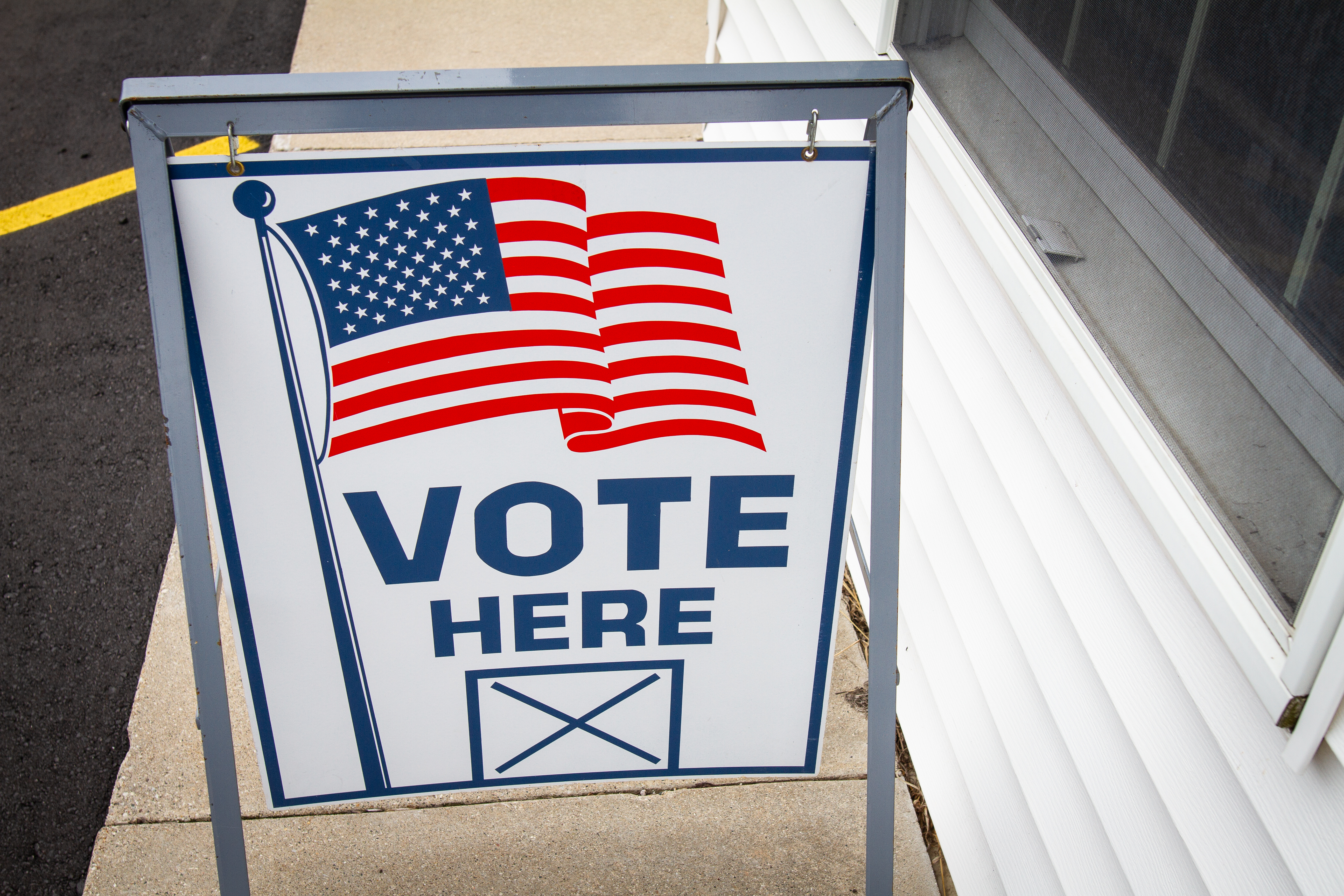 "A ""vote here"" sign sits outside of the Hopkins Township hall in Hopkins, Michigan, on Tuesday, May 5, 2020. While some polling places were open to in-person voting, most Michigan residents cast ballots in the May 5 election by absentee voting to prevent the spread of COVID-19. (WWMT/Sarah White)"