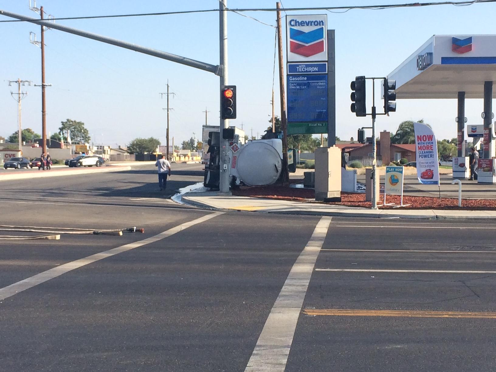 Streets are closed at Panama Lane and South Union Avenue in Bakersfield, Calif., after a big rig overturned and started spilling something Aug. 9, 2017. (KBAK/KBFX photo/Kyle Harvey)
