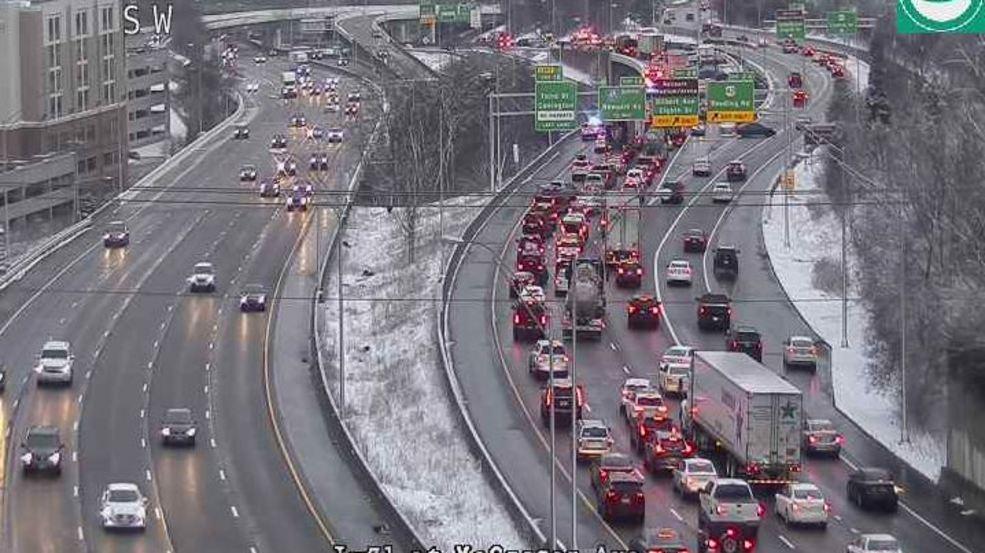 Multi-vehicle accident due to slick roads shuts down I-71 near