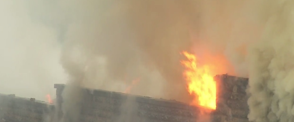 Flames engulf a building in Madison that houses businesses and apartments. (WCHS/WVAH)