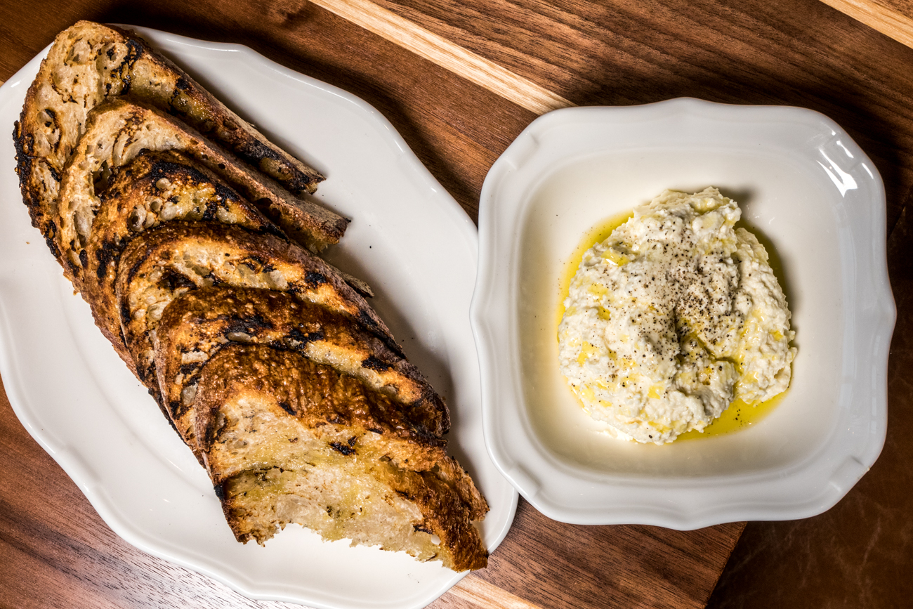 Housemade Ricotta: grilled Allez Bakery sourdough, olive oil, and sea salt / Image: Catherine Viox // Published: 2.11.20
