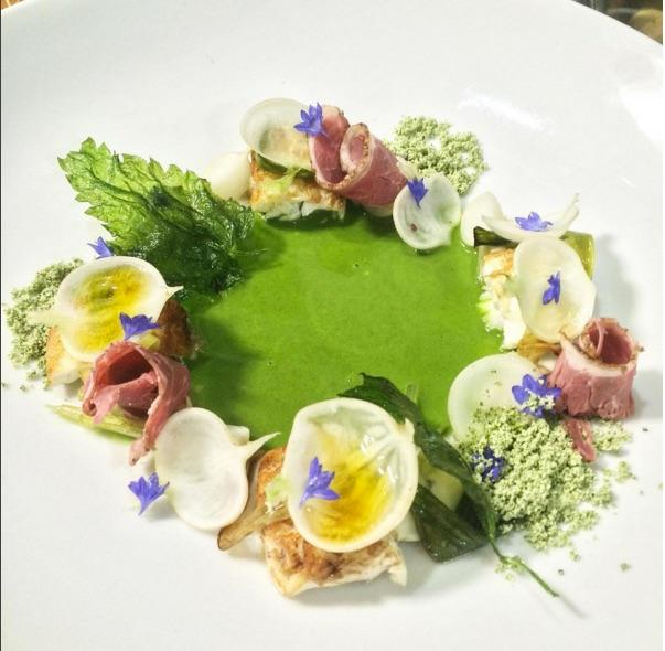 Rare halibut, lavender cured lamb ham, cultured cream and turnip espuma, confit of baby turnip and citron, wild nettle nage, fresh turnip and radish, forest floor gastrique, wild nettle and lamb fat pow, nettle chips. (Image: @maximillianpetty / Instagram)