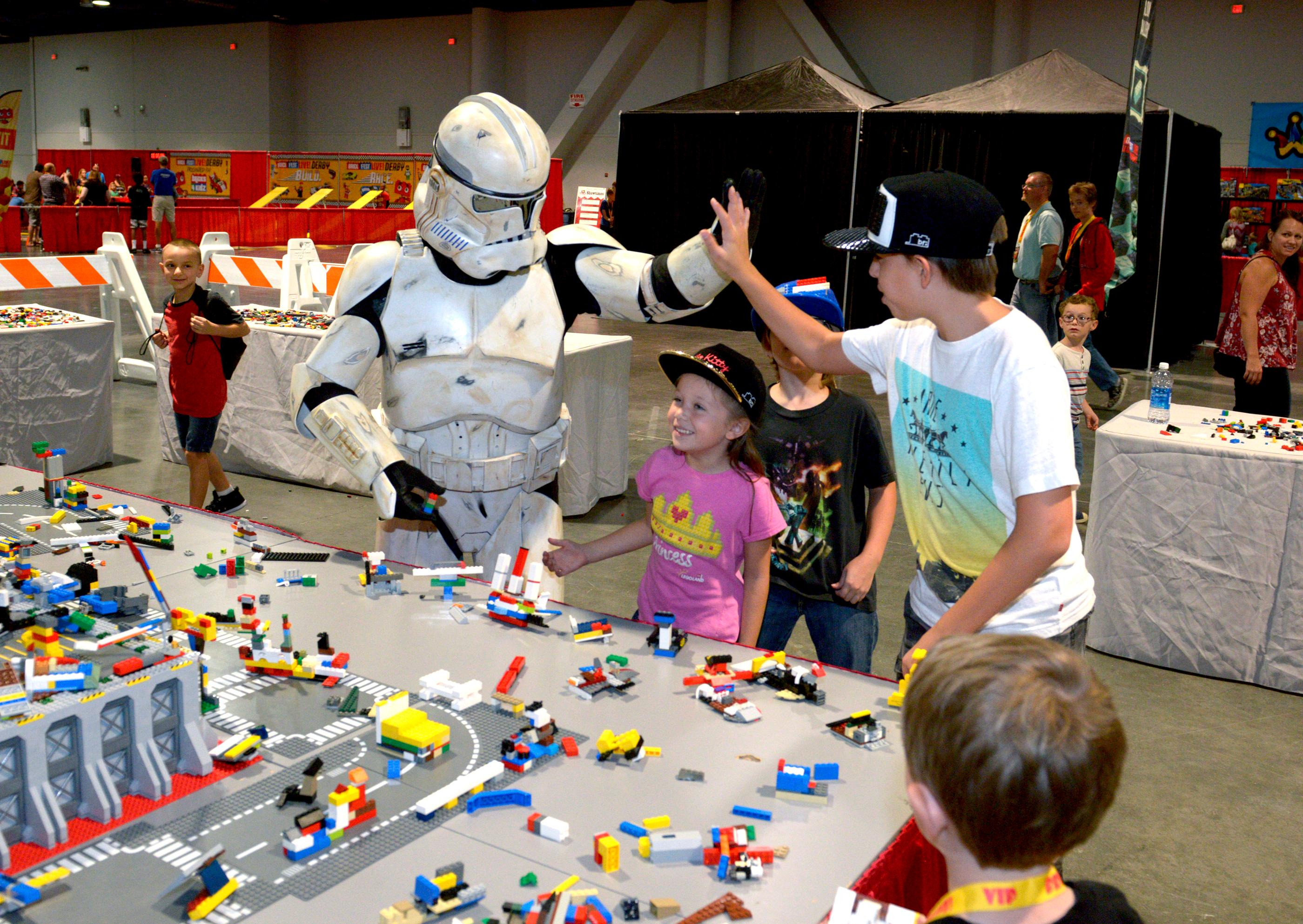 A Galactic Empire Stormtrooper helps put together rockets, space ships and other-worldly vehicles in the Space Station area of Brick Fest Live Lego Fan Experience at the Las Vegas Convention Center, September 9, 2017. [Glenn Pinkerton/Las Vegas News Bureau]