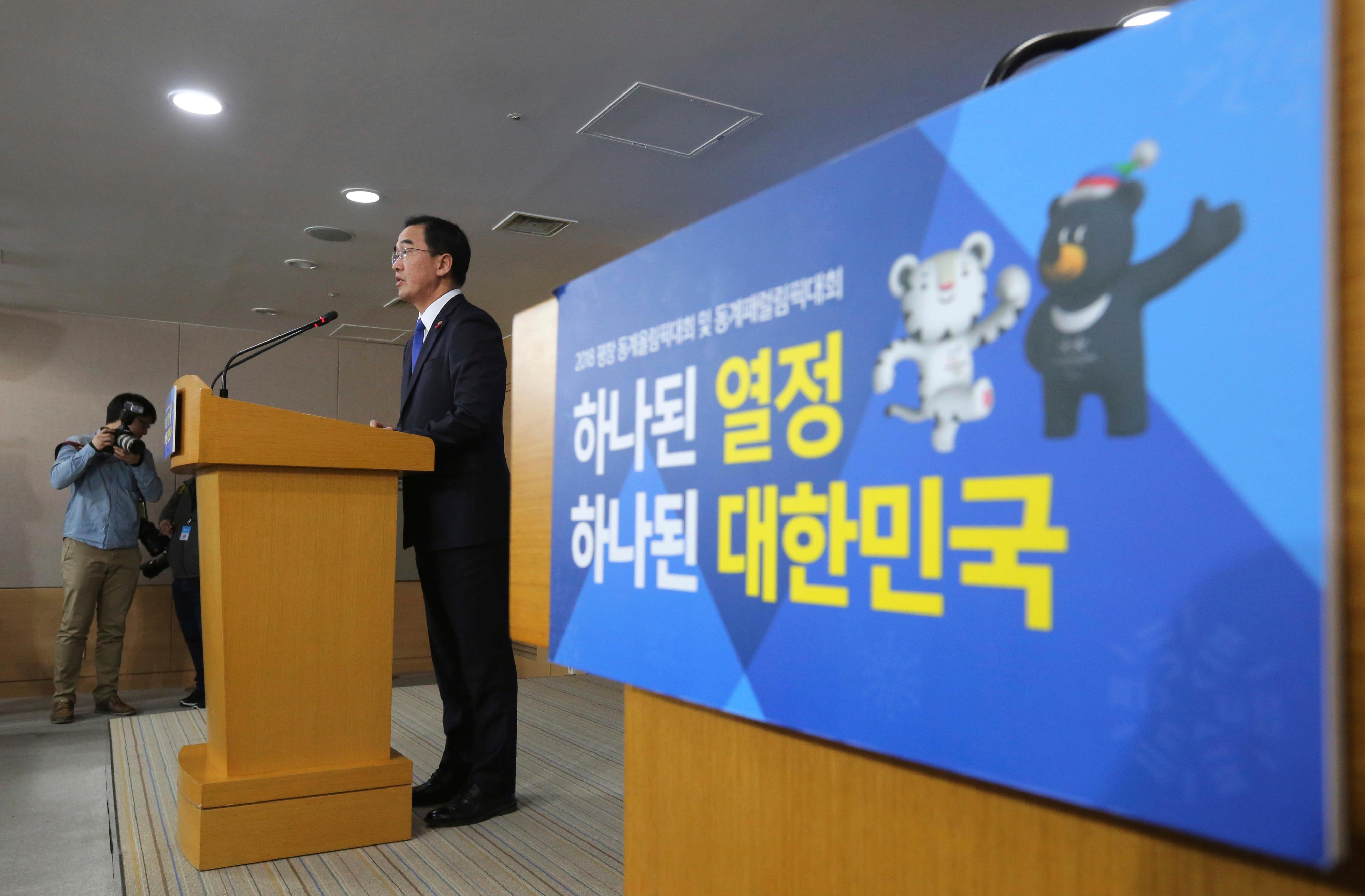 "South Korean Unification Minster Cho Myoung-gyon speaks during a press conference at the government complex in Seoul, South Korea, Tuesday, Jan. 2, 2018. Cho on Tuesday offered high-level talks with rival North Korea meant to find ways to cooperate on the Winter Olympics set to begin in the South next month. The banner showing the 2018 Pyeongchang Winter Olympics slogan reads: ""Passion. Connected."" (AP Photo/Ahn Young-joon)"