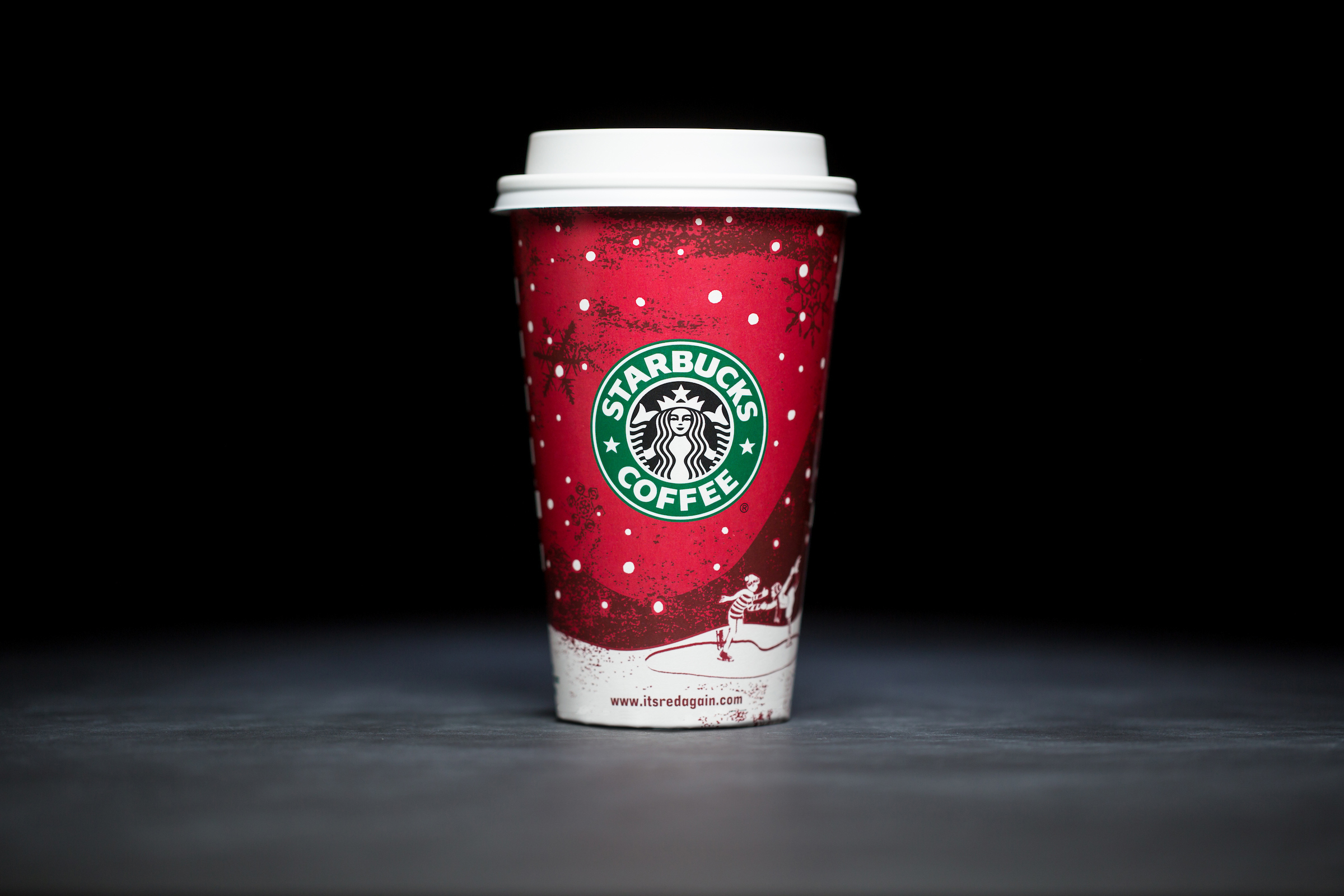 2007: For 20 years, Starbucks have released a range of holiday cup designs, most of them based around their world famous red cup. It's not easy to find the very first Starbucks holiday cups, which made their debut in stores in 1997. Few were saved, and electronic design files were lost in an earthquake in 2001. Even an Internet search is unyielding, with the cups having made their arrival long before the first selfie. But, we have them here! Click on for a photos of all 20 holidays cup designs. (Image: Joshua Trujillo/Cover Images)