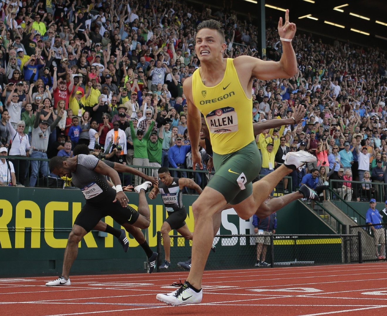 Devon Allen celebrates his win in the finals of the men's 110-meter hurdles at the U.S. Olympic Track and Field Trials, Saturday, July 9, 2016, in Eugene Ore.  (AP Photo/Matt Slocum)