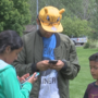 Locals play Pokemon Go to help those in need