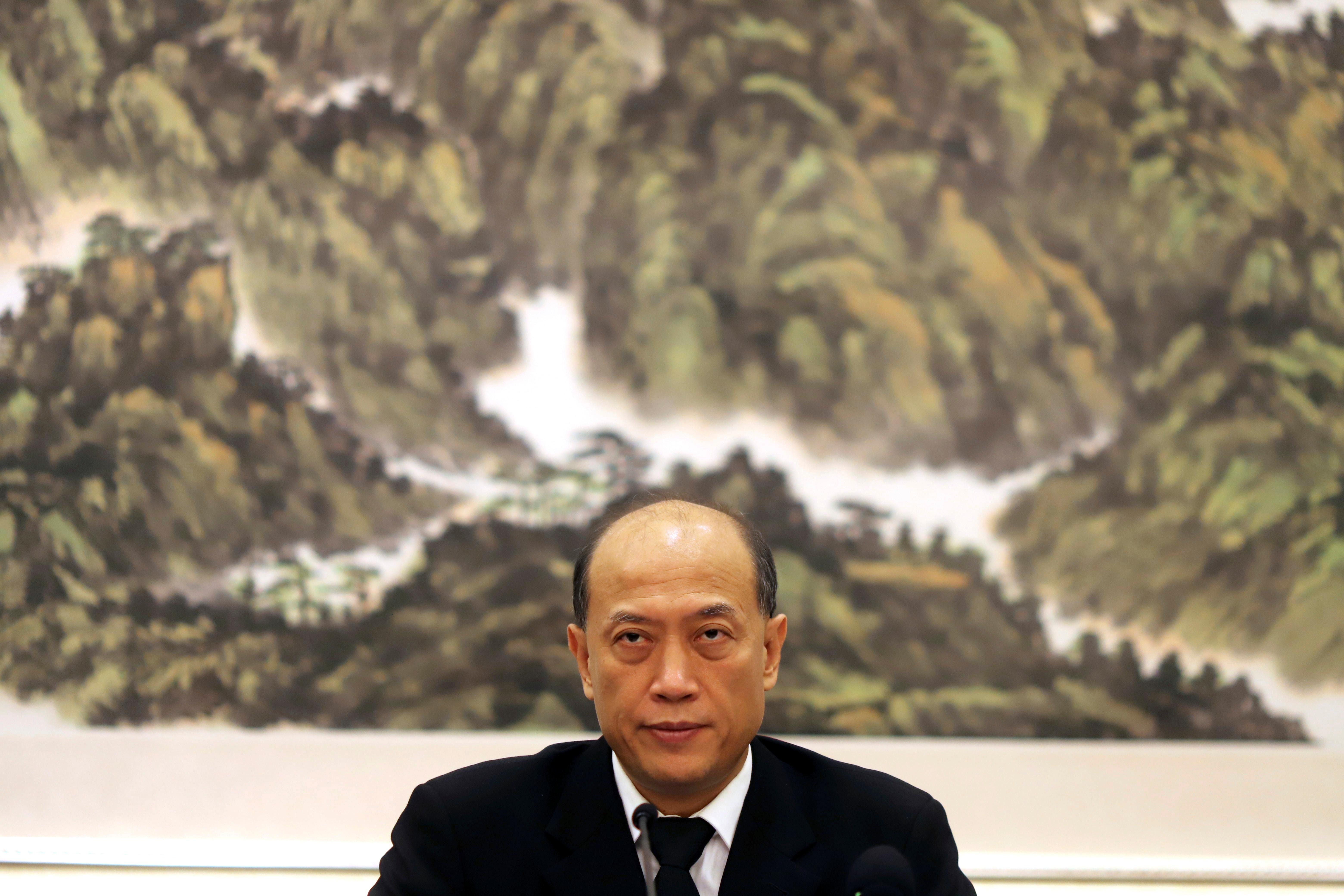 Deng Ming, Deputy Secretary-General of the China National Narcotics Control Commission attends a press conference held in Beijing, China, Thursday, Dec. 28, 2017. A top Chinese drug enforcement official says the United States needs to do more to fight its opioid epidemic, including sharing more data and police intelligence with Chinese counterparts. (AP Photo/Ng Han Guan)