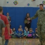 Military dad surprises kids with early homecoming