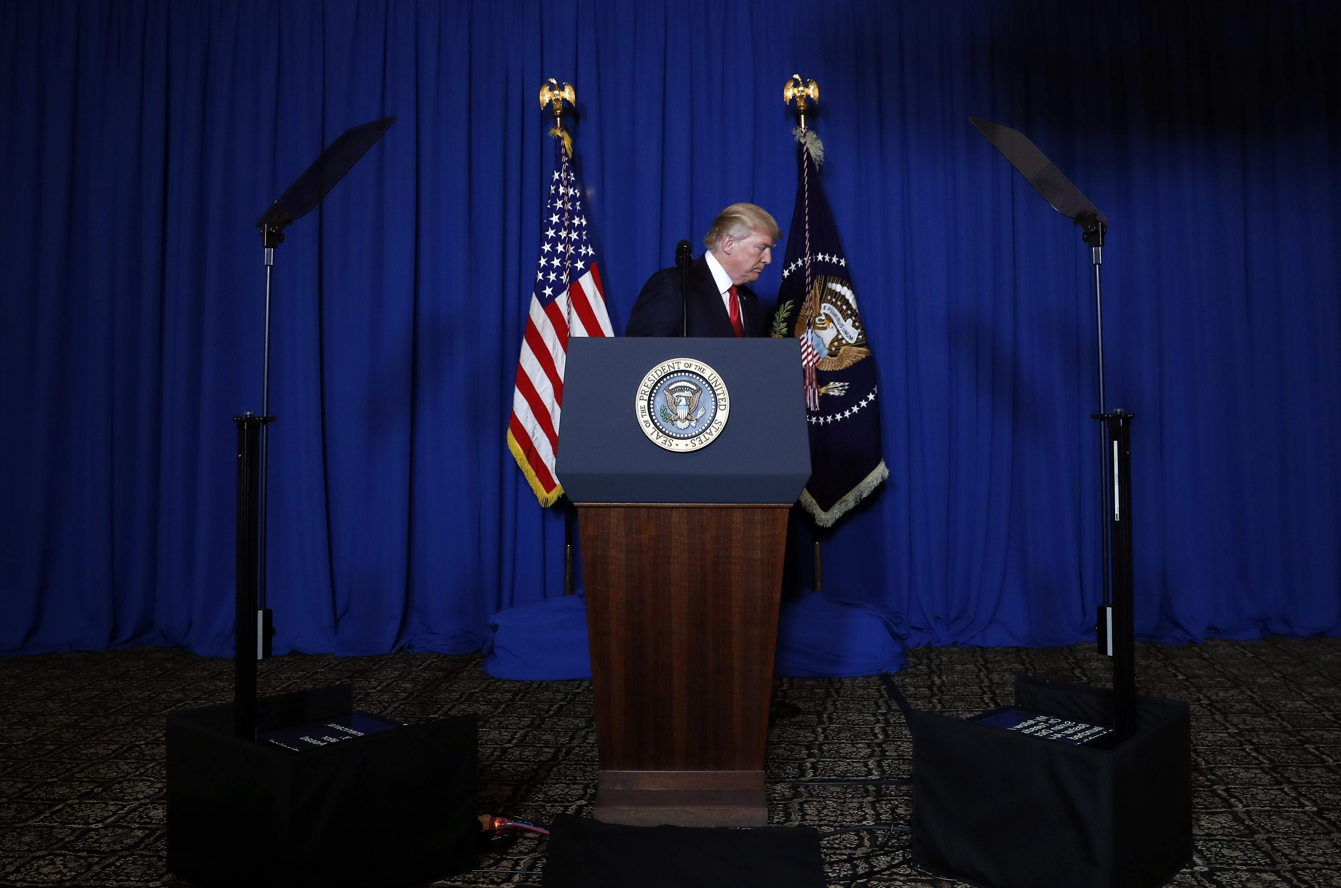 DAY 77 - In this April 6, 2017, file photo, President Donald Trump walks from the podium after speaking at Mar-a-Lago in Palm Beach, Fla., Thursday, April 6, 2017, after the U.S. fired a barrage of cruise missiles into Syria. (AP Photo/Alex Brandon, File)