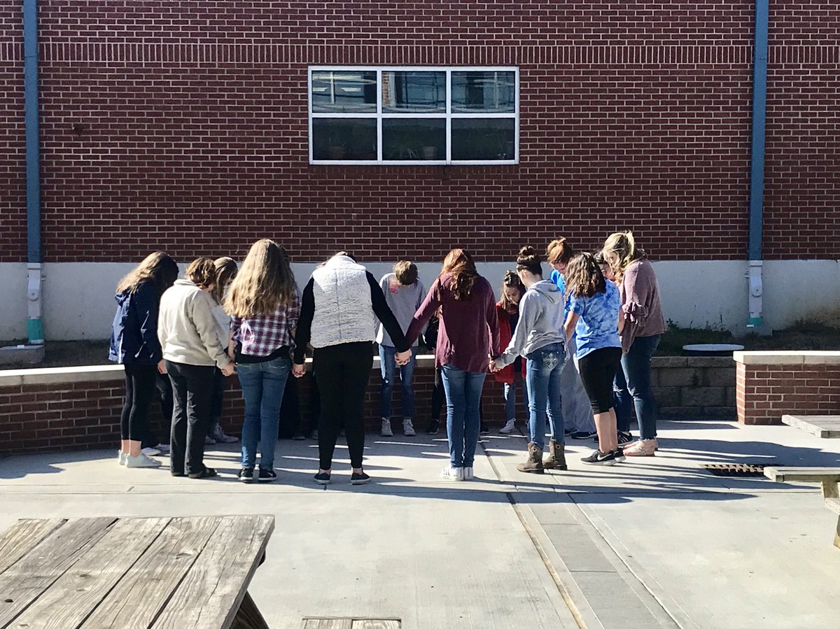 Students pray at Ridgeland High School. Photo via Ridgeland High School Twitter.