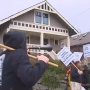 Tenants allege poor living conditions, picket landlord's home