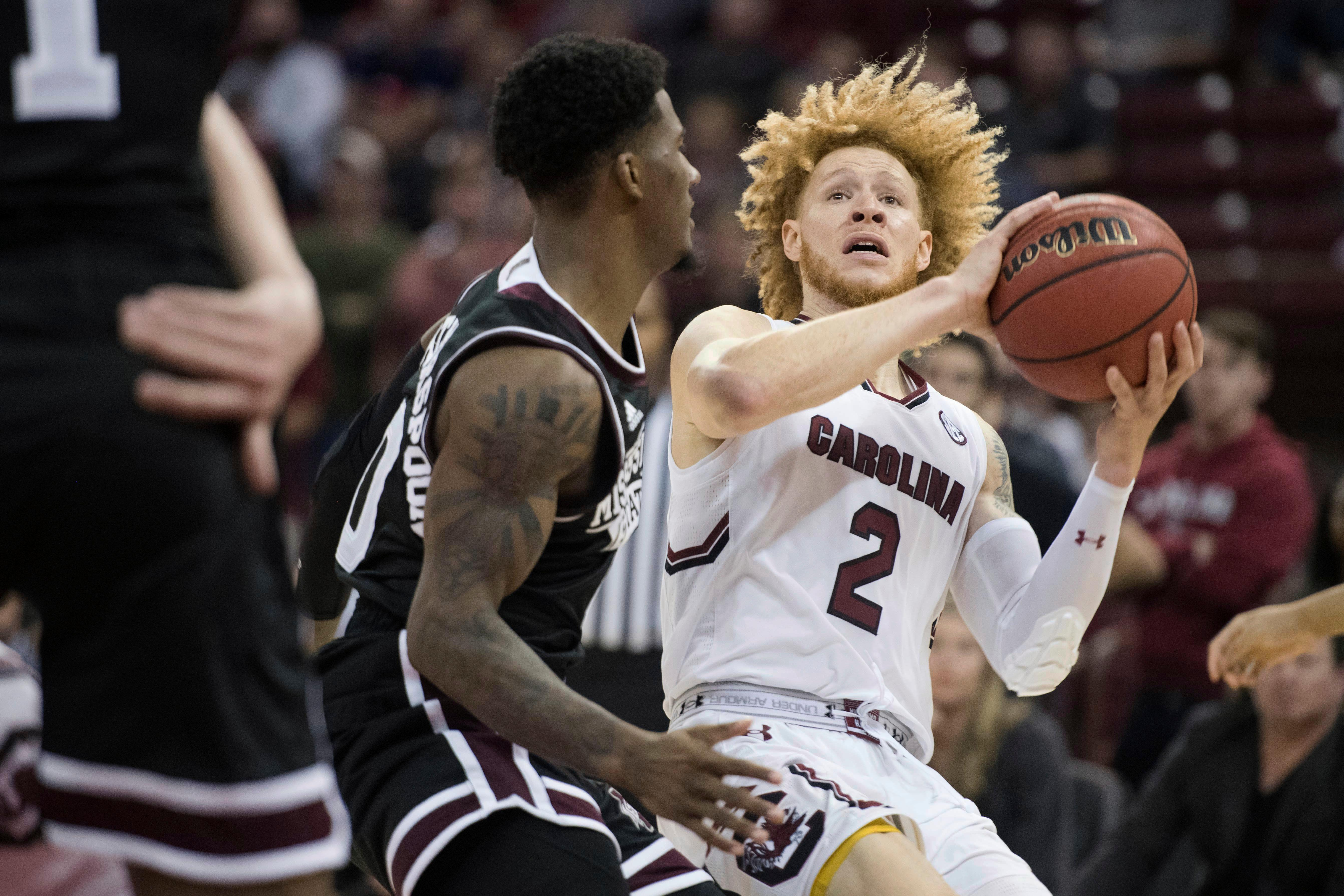 South Carolina guard Hassani Gravett (2) drives as Mississippi State guard Nick Weatherspoon (0) defends during the second half of an NCAA college basketball game Tuesday, Jan. 8, 2019, in Columbia, S.C. South Carolina won 87-82. (AP Photo/Sean Rayford)
