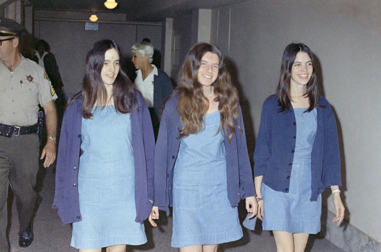 FILE - In this Aug. 20, 1970 file photo, Charles Manson followers, from left: Susan Atkins, Patricia Krenwinkel and Leslie Van Houten, walk to court to appear for their roles in the 1969 cult killings of seven people. (AP Photo/George Brich, File)