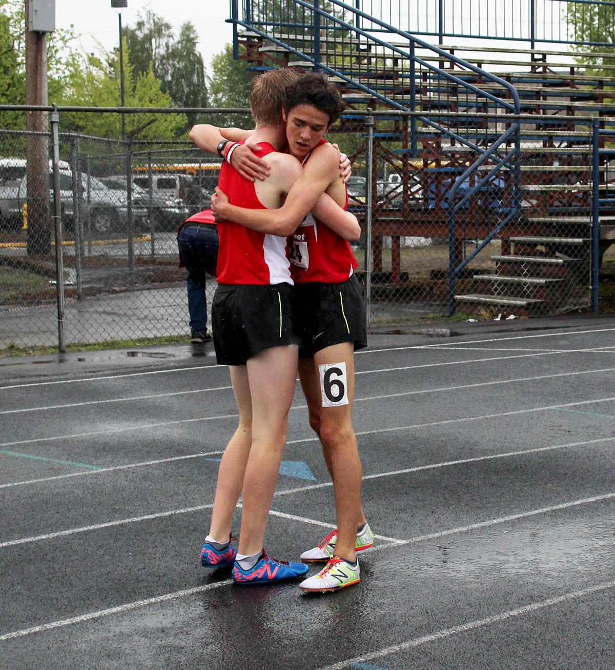 Runner congratulate each other at the 5A-3 Midwestern League District Track Championship meet. Photo by Elle Page, Oregon News Lab