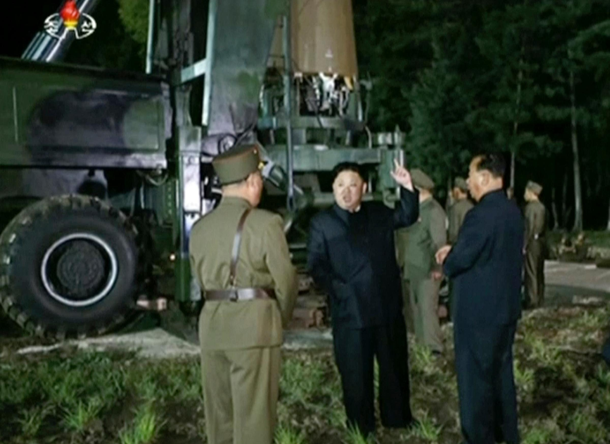 FILE - In this file image made from video by North Korea's KRT released on July 28, 2017, North Korean leader Kim Jung Un, second from right, gestures at the site of a missile test at an undisclosed location in North Korea. (KRT via AP Video, File)