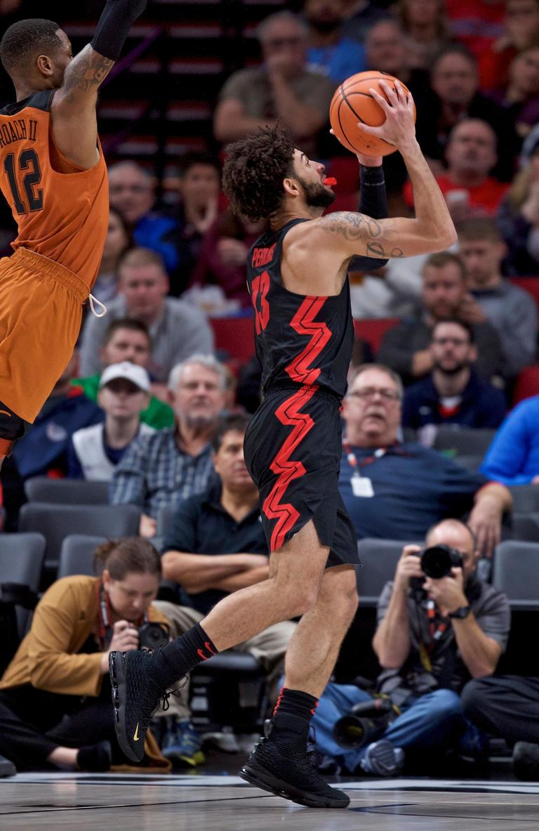 Gonzaga guard Josh Perkins, right, shoots over Texas guard Kerwin Roach II during the second half of an NCAA college basketball game in the Phil Knight Invitational tournament in Portland, Ore., Sunday, Nov. 26, 2017. (AP Photo/Craig Mitchelldyer)