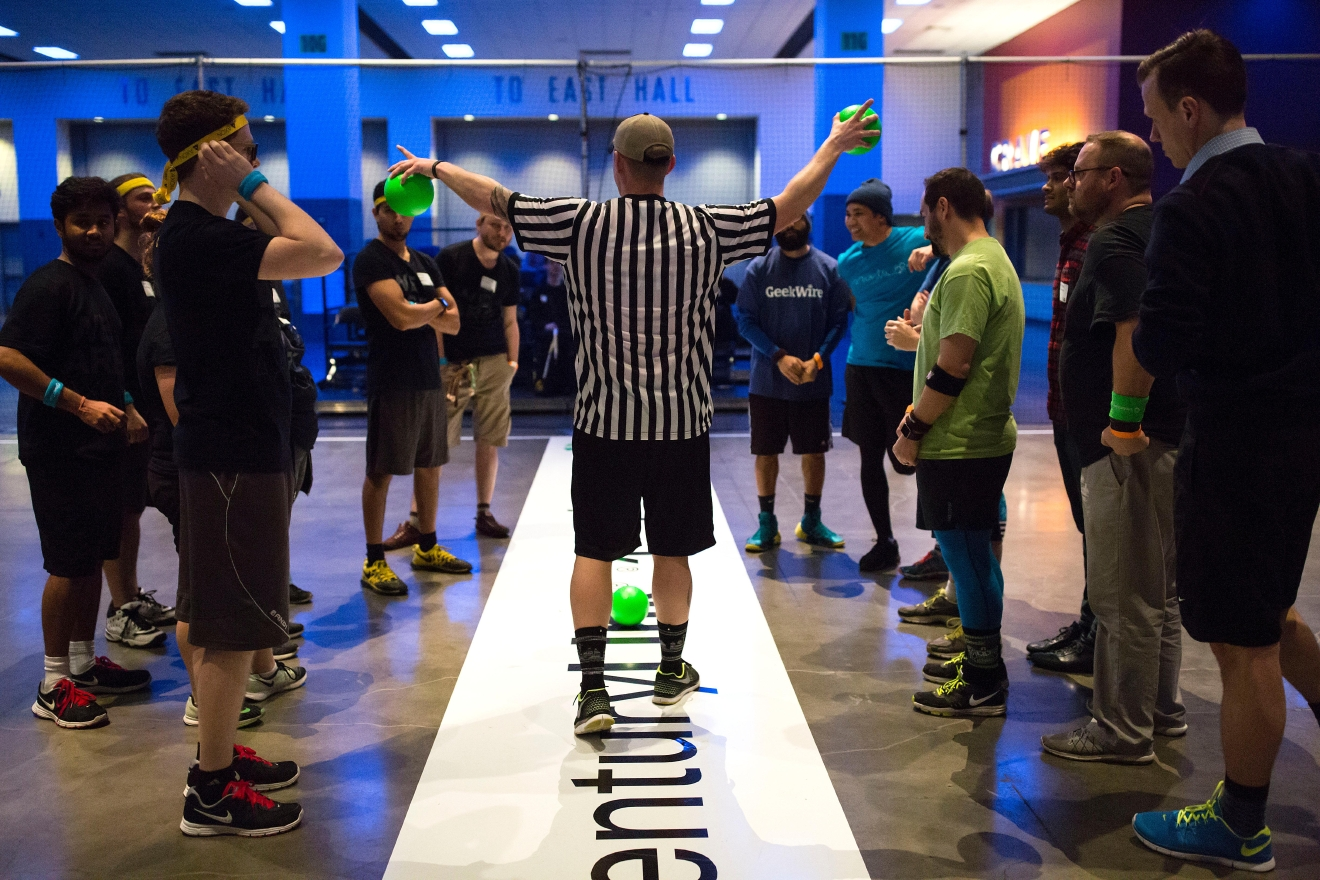 Dodgeball participants hear the rules before competing in one of the tournament heats at the 6th annual Geekwire Bash at the CenturyLink Event Center. (Sy Bean / Seattle Refined)