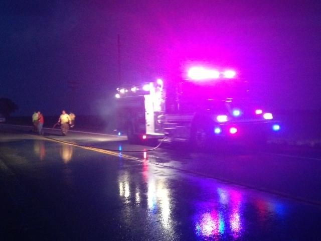 New London Fire Department clearing Highway 19 after accident.