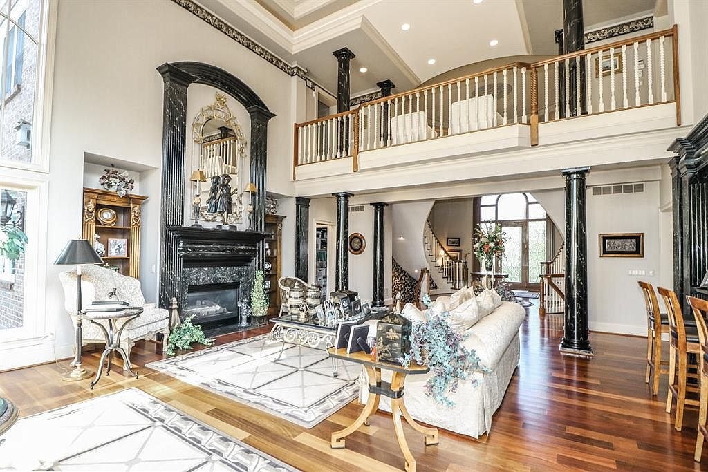 9435 Shawnee Run Road in Indian Hill - $3,475,000 / This is definitely the biggest home on the list. At a whopping 8,347 square feet, this six-bedroom, nine-bathroom mansion in Indian Hill is situated on over five acres of land and is surrounded by woods. For those who want to escape the city and live in nature, this is it. The place has its own indoor basketball court, a theater, a full bar, a pool, a tennis court, a double curved staircase...the list goes on. / Our favorite feature: That grand entry is pretty slick, not gonna lie. / Image: Andrew Desenberg // Published: 1.9.20