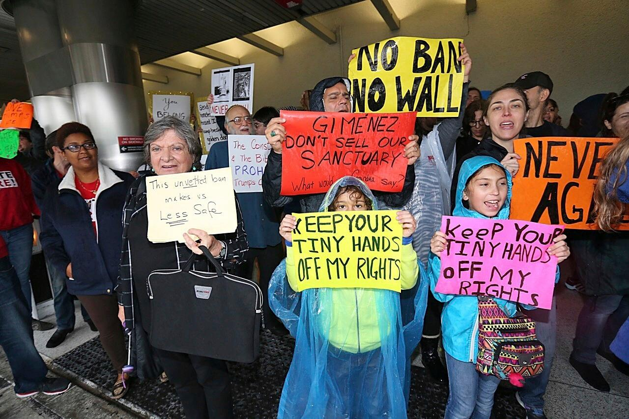 Protesters rally against President Trump's refugee ban at Miami International Airport on Sunday, Jan. 29, 2017. (C.M. Guerrero/El Nuevo Herald via AP)