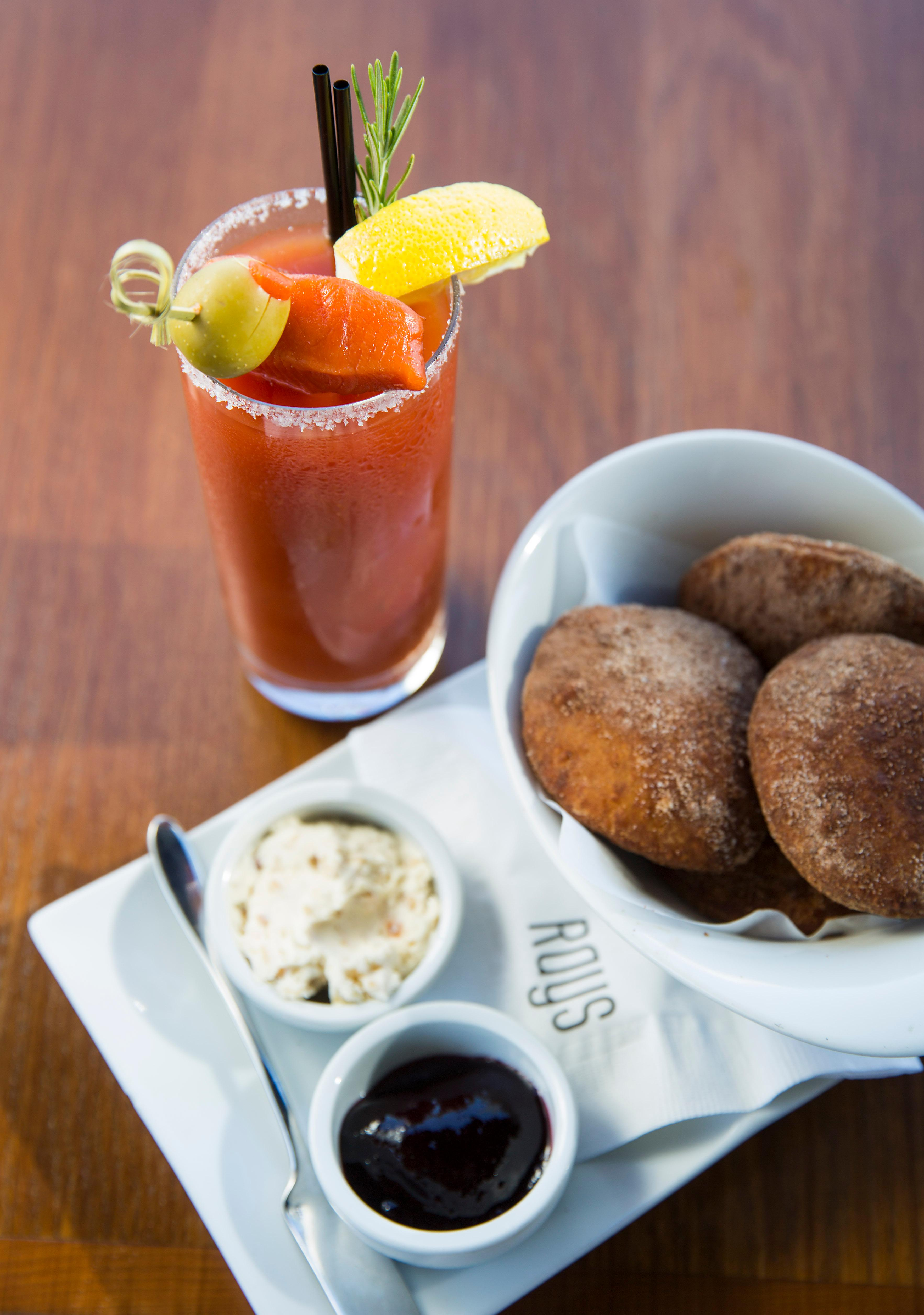 House-Made Beignets, with hazelnut mascarpone and Marion berry jam 12, served next to a Rays Bloody Mary with smoked salmon, at Ray's Boathouse in Ballard. Ray's Boathouse launched its first ongoing weekend brunch for the first time in its 44-year history, and guests can now enjoy Ray's beautiful setting over brunch each weekend. (Sy Bean / Seattle Refined)