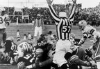 In this Dec. 31, 1967 file photo, Green Bay Packers quarterback Bart Starr (15) digs his face across the goal line to score the winning touchdown against the Dallas Cowboys to bring the Packers their third consecutive NFL championship, in Green Bay.