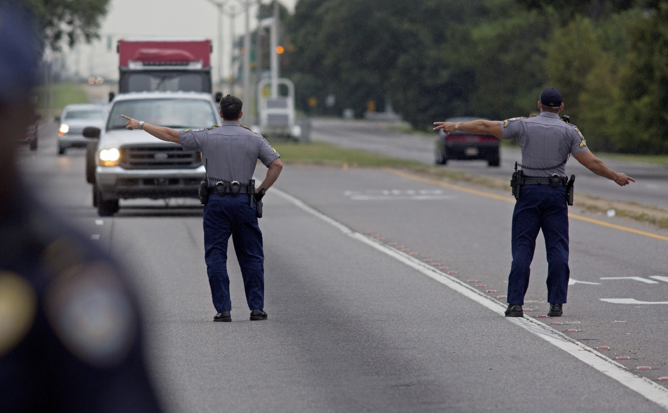 State Police block direct traffic off Airline Highway after Baton Rouge police were shot in Baton Rouge, La., on Sunday, July 17, 2016.  Multiple law enforcement officers were killed and wounded Sunday morning in a shooting near a gas station in Baton Rouge, less than two weeks after a black man was shot and killed by police here, sparking nightly protests across the city. (AP Photo/Max Becherer)