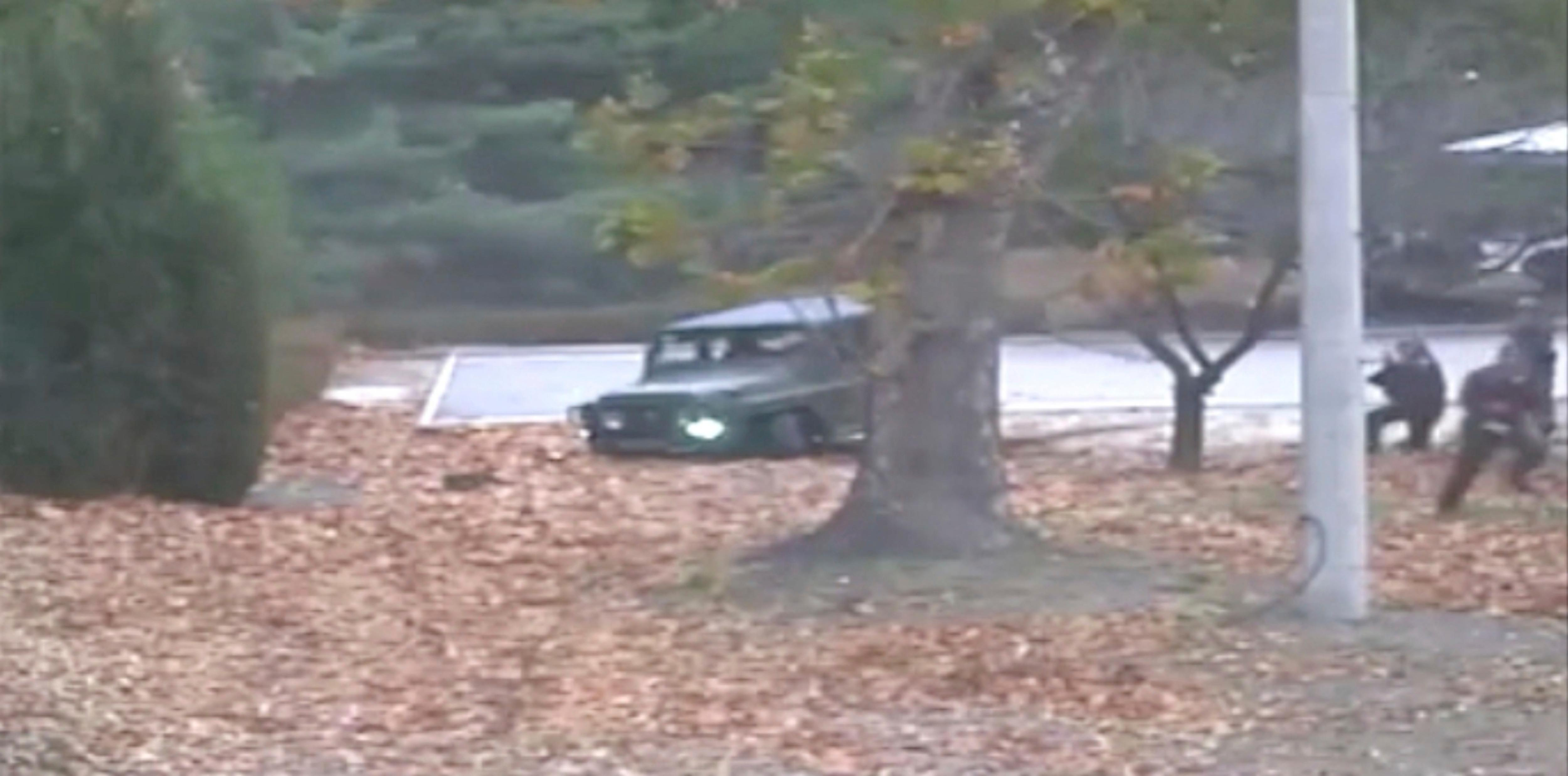 This image made from Nov. 13, 2017, surveillance video released by the United Nations Command shows a North Korean soldier running from a jeep and later shot by North Korean soldiers in Panmunjom, North Korea. A North Korean soldier made a desperate dash to freedom in a jeep and then on foot, being shot at least five times as he limped across the border and was rescued by South Korean soldiers, according to dramatic video released by the U.S.-led U.N. command Wednesday, Nov. 22, 2017. (United Nations Command via AP)