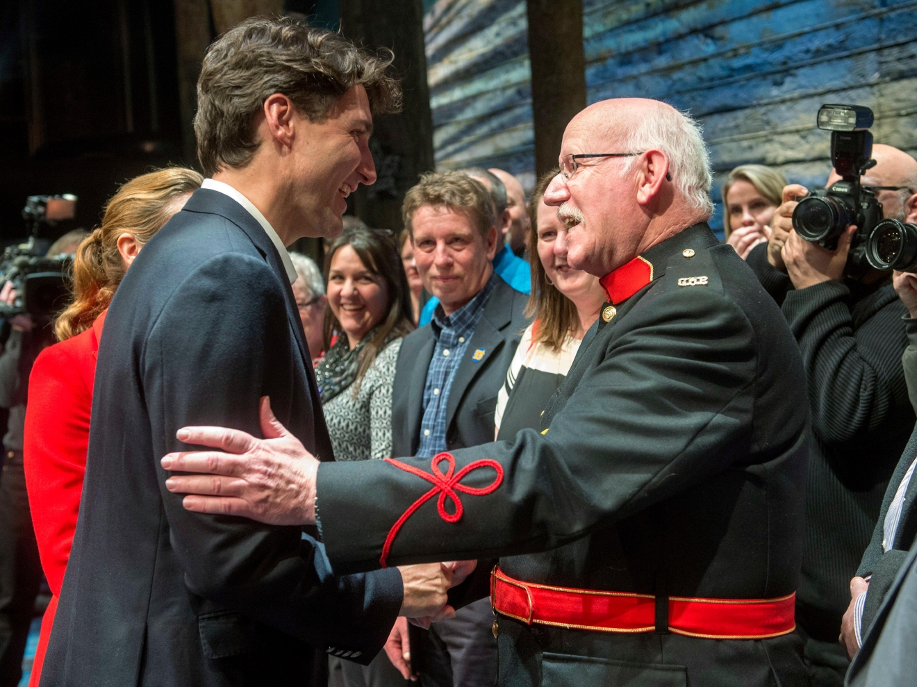 "Canadian Prime Minister Justin Trudeau, left, and his wife Sophie Gregoire, behind, greet some of the citizens from Gander, Newfoundland, after the Broadway musical ""Come From Away"" in New York on Wednesday, March 15, 2017. Trudeau, along with first daughter Ivanka Trump, have welcomed the new musical that celebrates Canadian compassion following 9/11. The musical is set in the small Newfoundland town of Gander, which opened its arms and homes to some 7,000 airline passengers diverted there when the U.S. government shut down its airspace. (Ryan Remiorz/The Canadian Press via AP)"